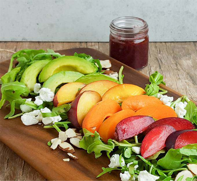 Peach, plum, and apricot salad with blackberry basil dressing. Summer's bounty in a healthy, easy salad. (It's also a fun rainbow salad)