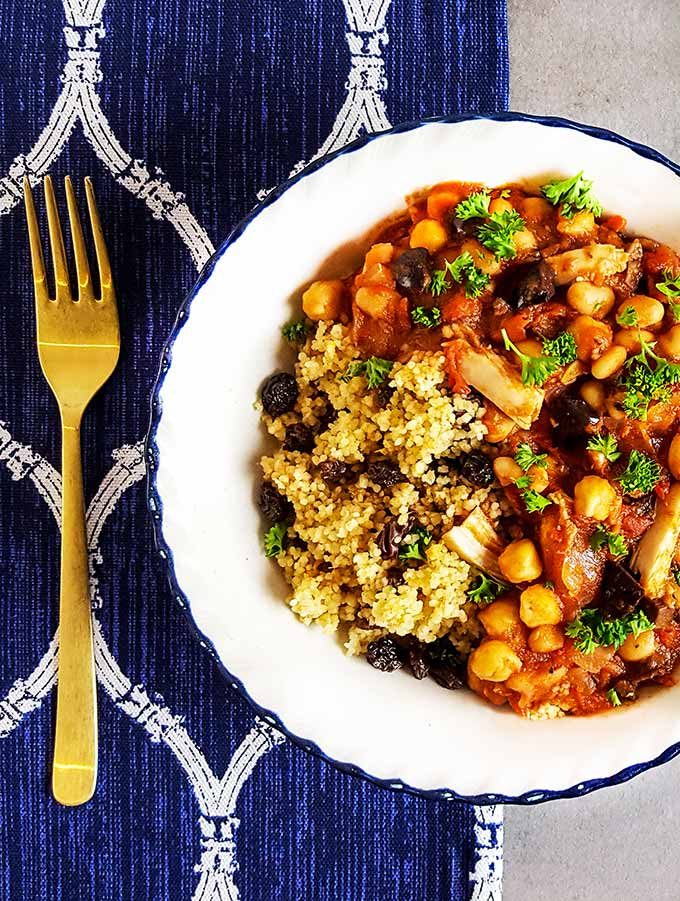 Dinner recipes | Moroccan chicken stew with orange & cinnamon couscous. The sweet & salty balance from raisins and olives makes this recipe addictive.   Couscous as a grain makes this gluten free.