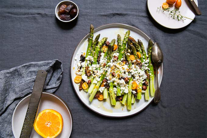 Asparagus, kumquats, dates and feta. AskTheFoodGeek.com recommends eating this at the very start of spring, when the end of kumquat season overlaps with the start of asparagus.