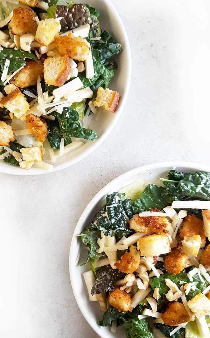 Salad recipes | Kale Caesar salad recipe with celery root and hazelnuts. This healthy recipe boosts your immune system and can even be filling enough to have as a salad for dinner.