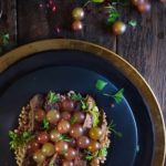 Seared steak with farro and roasted muscat grapes