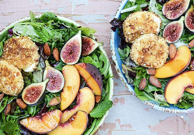 Almond-crusted goat cheese, fig, and peach salad by Floating Kitchen