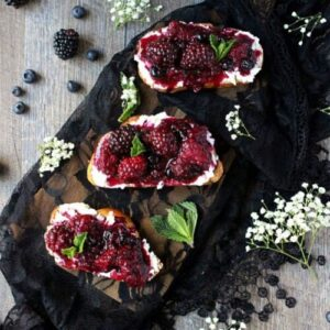 Smashed blackberry goat cheese toasts by Wry Toast