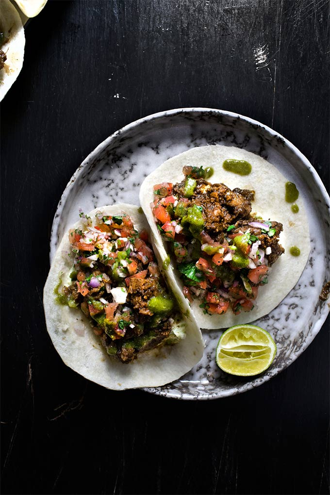 Jerk pork tacos with kiwi salsa verde - by Lady & Pups