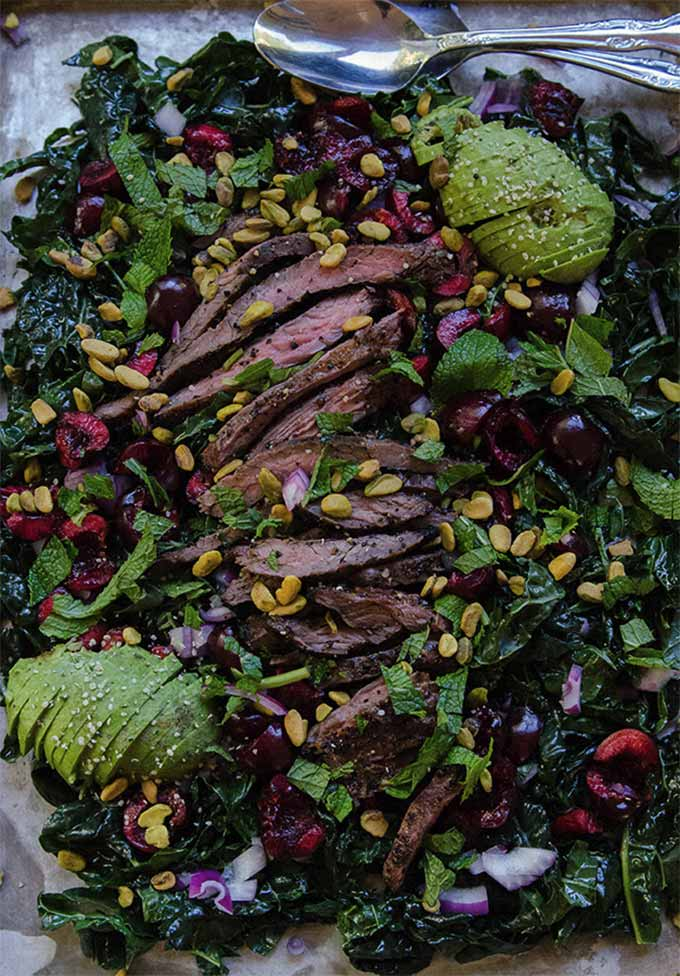 Kale salad with cherries, pistachios and grilled flank steak - By So Let's Hang Out
