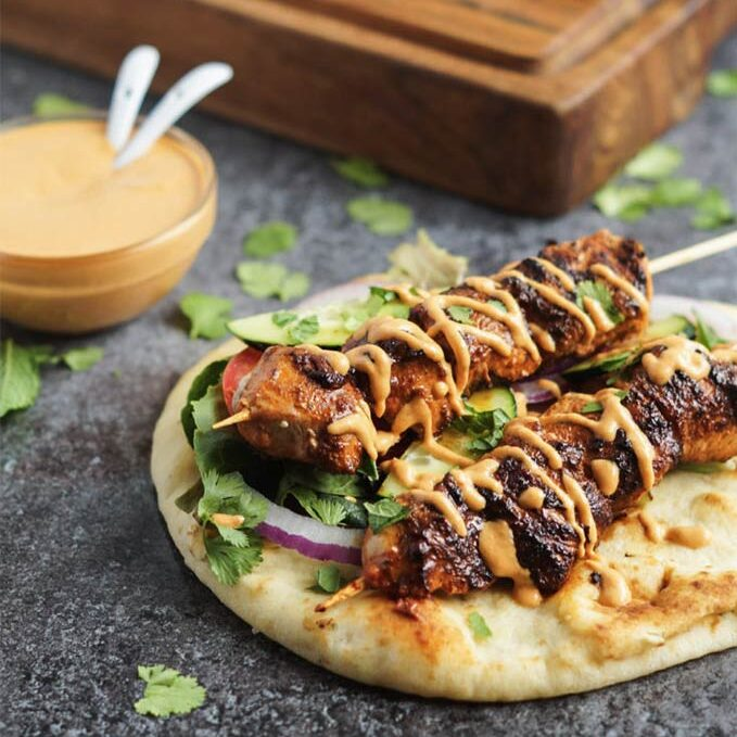Bell pepper recipes in season: Grilled chicken naan with roasted red pepper tahini by Tara's Multicultural Table