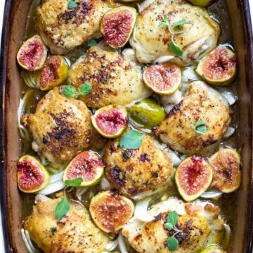 A pan of chicken thighs with figs