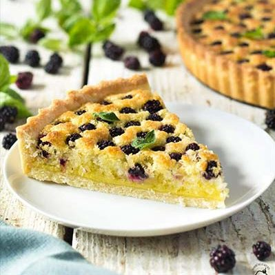 A slice of blackberry coconut tart