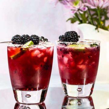 2 glasses of blackberry jalapeno margaritas