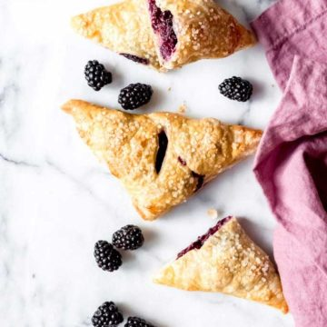 Blackberry turnovers on a marble counter