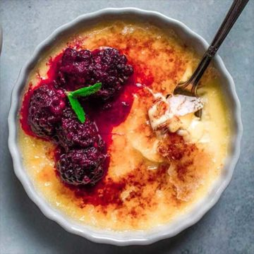 creme brulee topped with blackberries