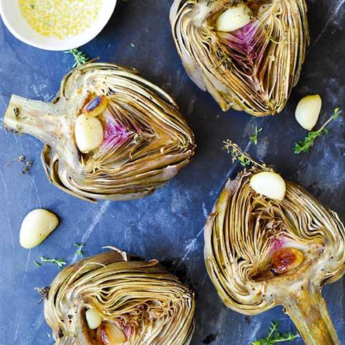 Artichoke halves with garlic cloves