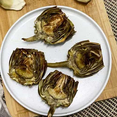 4 artichoke halves on a plate