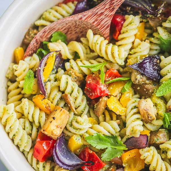 pasta salad with onions and bell peppers. Recipe by Nourish Plate.