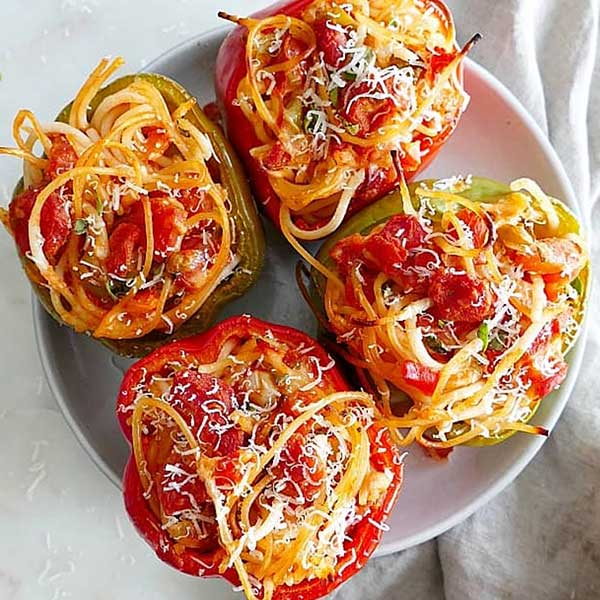 Bell pepers stuffed with spaghetti. Recipe by It's a Veg World