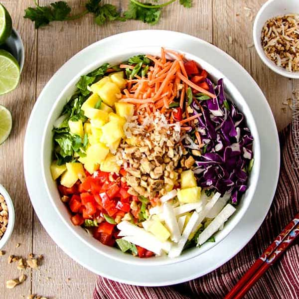 Asian pineapple salad with peanut dressing and peanuts. Recipe by Carlsbad Cravings