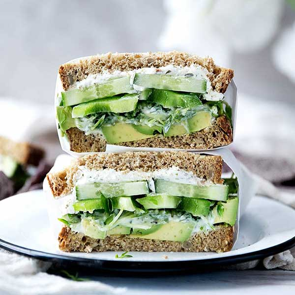 Sandwich with avocado, cucumbers, and green bell peppers. Recipe by Broma Bakery.