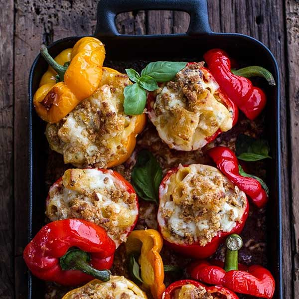 A tray of bell peppers stuffed with mac & cheese