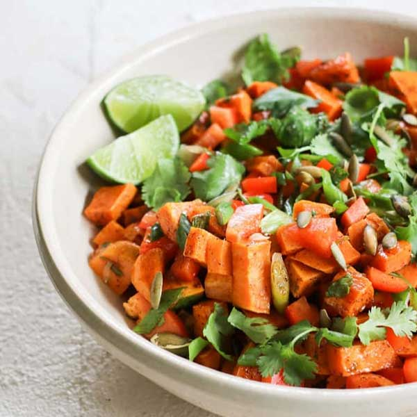 Sweet potato salad with dressing limes, bell peppers, and cilantro. Recipe by G-free Foodie.