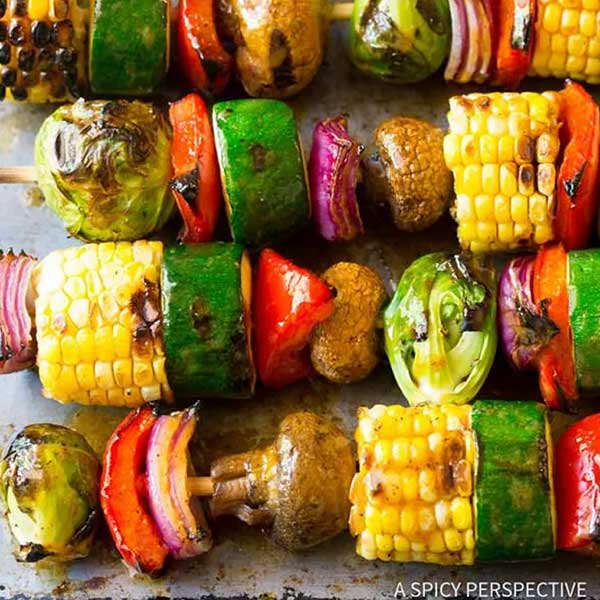 Kabobs with bell peppers, mushrooms, corn, and zucchini. Recipe by A Spicy Perspective