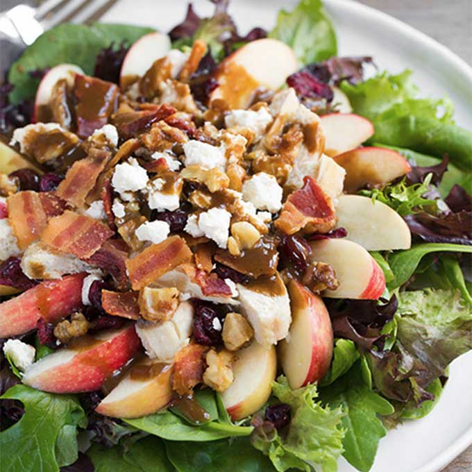 A salad with apples, bacon, feta, and chicken. Recipe by Cooking Classy