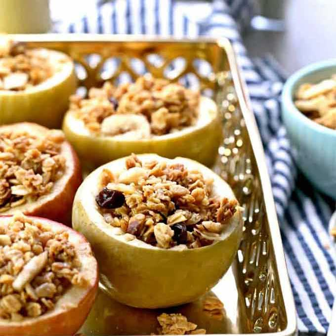 Apples cut in half and stuffed with granola. Recipe by The Cookie Rookie.