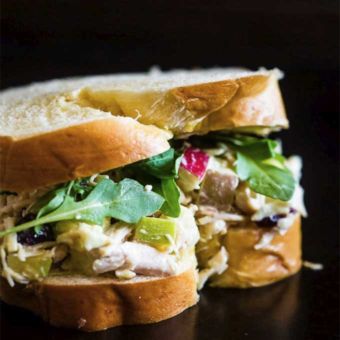 Chicken salad sandwich with apples and hummus. Recipe by Nutmeg Nanny.