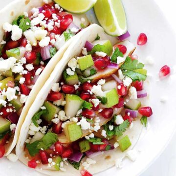 Tacos with pears and pomegranate seeds. Recipe by Gimme Some Oven.