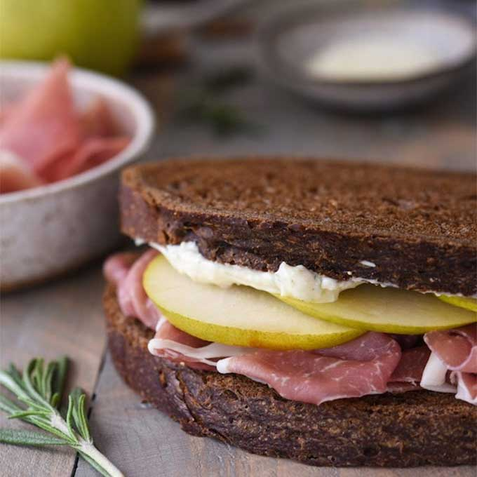 Rye bread sandwich with pears and prosciutto. Recipe by Foxes Love Lemons.