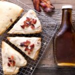 A rack of bacon scones topped with a maple glaze and crumbled bacon