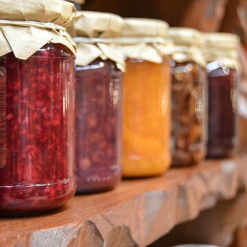 A row of jars filled with jam