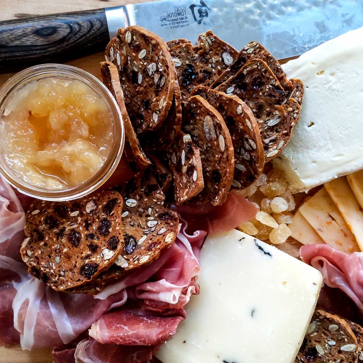 Peach jam on a charcuterie meat and cheese board