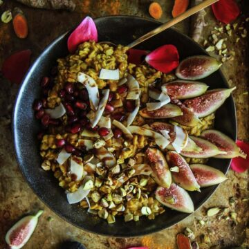 A bowl of oatmeal with figs and pomegranate arils
