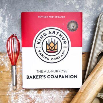 King Arthur Baking Companion cookbook with baking tools