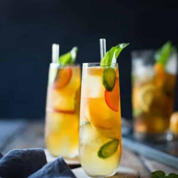 Basil-plum Pimm's Cup cocktails. Recipe by Bojon Gourmet