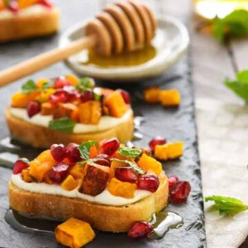 Butternut squash and pomegranate crostini with whipped feta and honey, recipe by Foxes love lemons