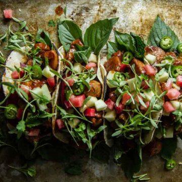 Pork tacos with plum and hoisin glaze. Recipe by Heather Christo