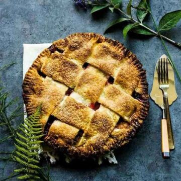 Plum pie with rosemary and ginger. Recipe by Box of Spice.
