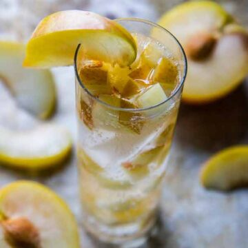 Vodka spritzer with plums. Recipe by Heather Christo