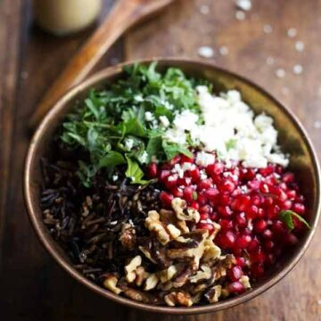 Pomegranate, kale, and wild rice salad with walnuts and feta, recipe by Pinch of Yum