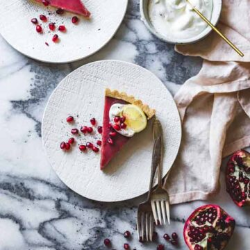 Pomegranate tart with hibiscus, lemon, and almond crust, recipe by Bojon Gourmet