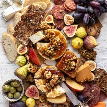 Fall cheese board with bourbon crackling caramel recipe by How Sweet Eats