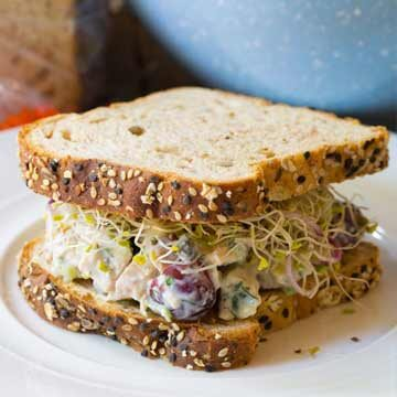 Chicken salad sandwich with grapes, cucumbers, and capers by A Spicy Perspective