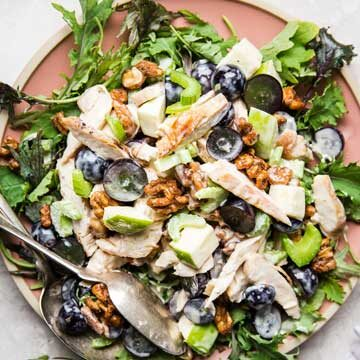 Chicken Waldorf salad with kale and candied walnuts by The Modern Proper