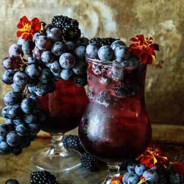 Concord grape, blackberry bourbon fizz by Heather Christo
