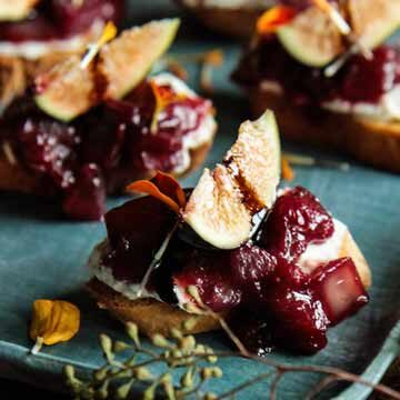 Caramelized cranberry-onion crostini topped with figs, a recipe by Heather Christo