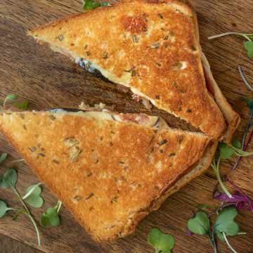 Fig and prosciutto grilled cheese with rosemary butter by Culinary Ginger