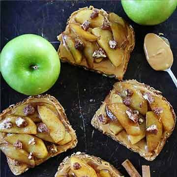 Peanut butter toast with skillet cinnamon apples by Two Peas & Their Pod